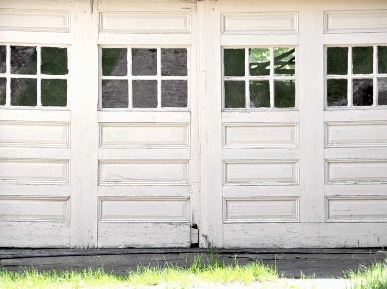 reasons to replace an old garage door