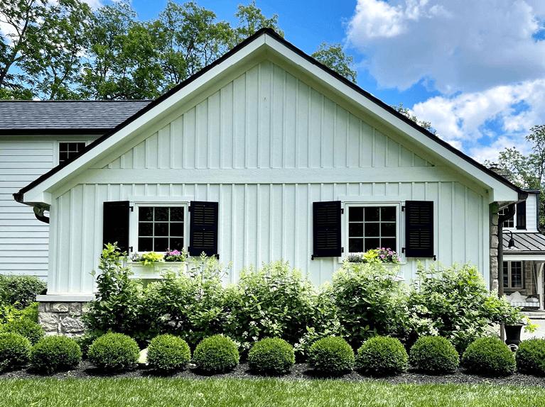 custom louver shutters on exterior of riverside home