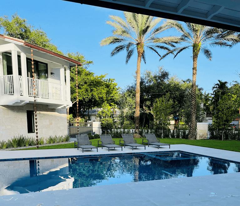 backyard pool of custom home in south florida