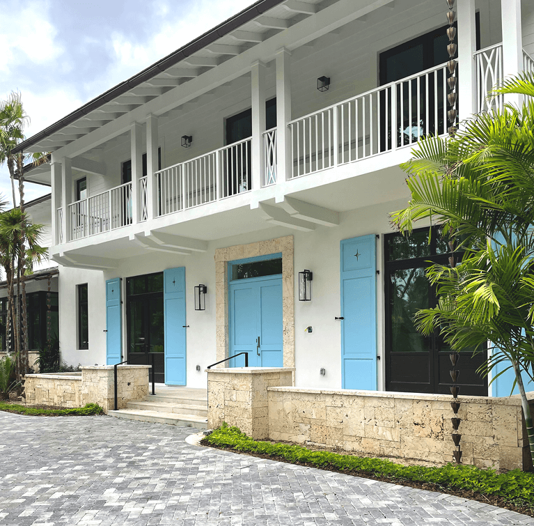south florida custom home with Timberlane exterior shutters
