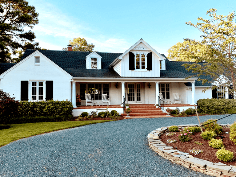 how to style a white home with black arch top shutters