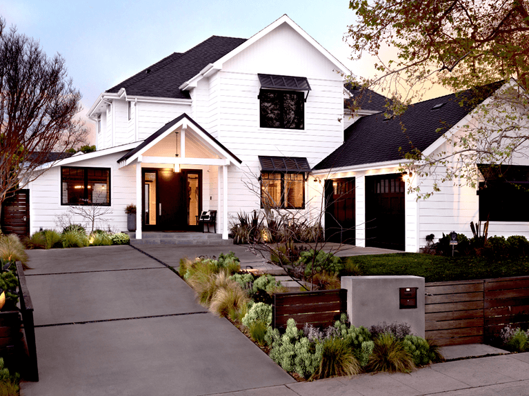 how to style a white home with black bermuda shutters
