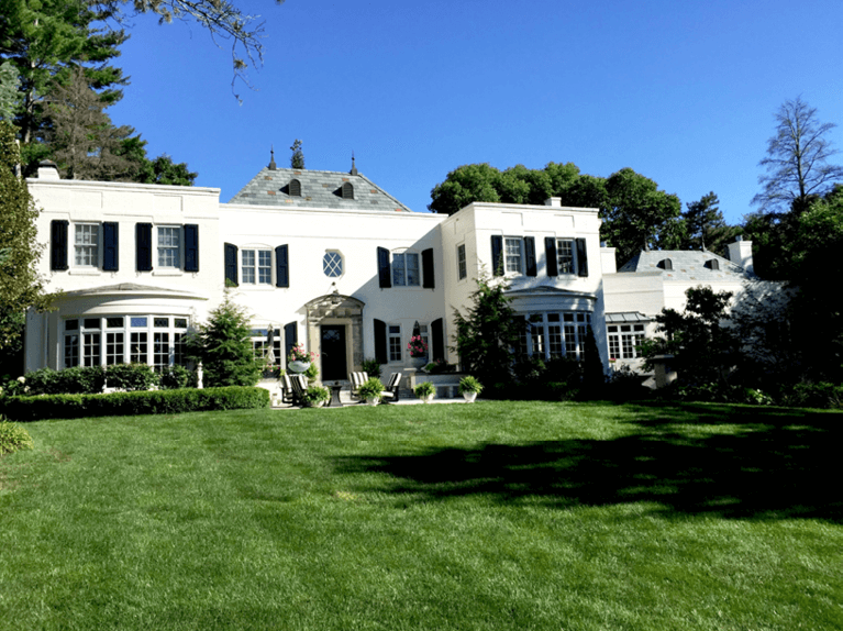 tips for styling a white historic home with black shutters