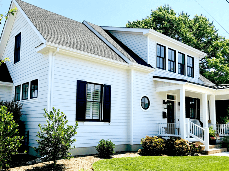 how to style a white home with black shutters and window trim