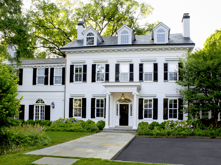how to style a white Colonial home with black shutters