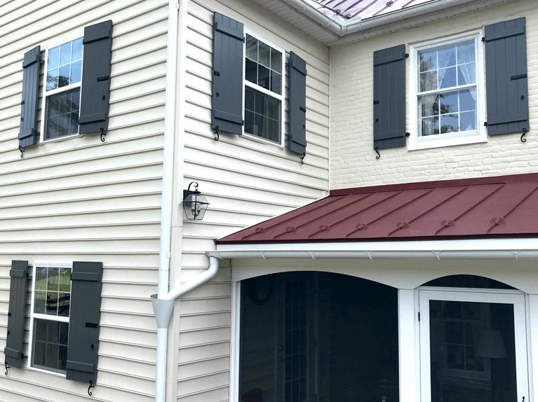 custom exterior shutters on historic farmhouse renovation