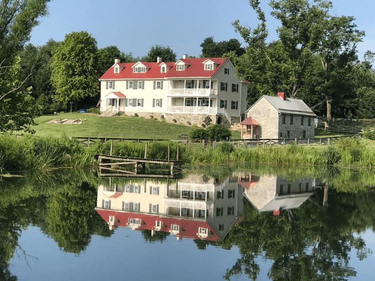 historic farmhouse renovation with custom exterior shutters