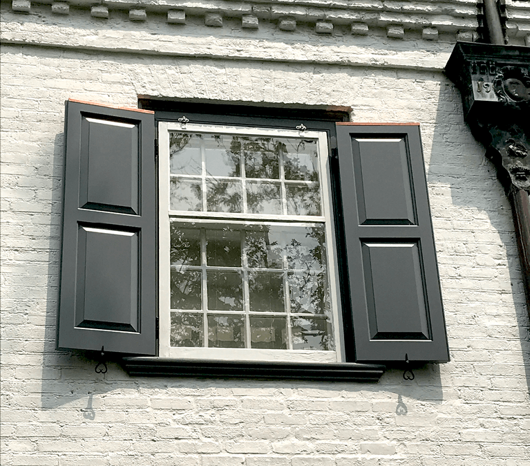 custom panel shutters for historical home restoration by hackley and associates architects