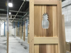 pineapple cutout in wood panel shutter
