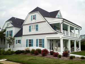 3-story beach house with blue louver shutters