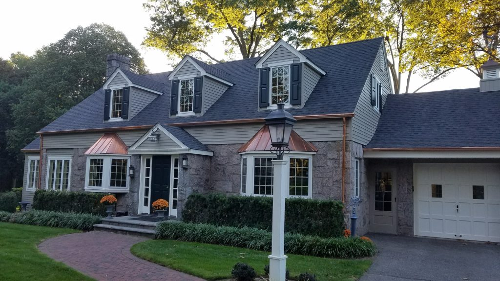 cape cod with functional exterior shutters