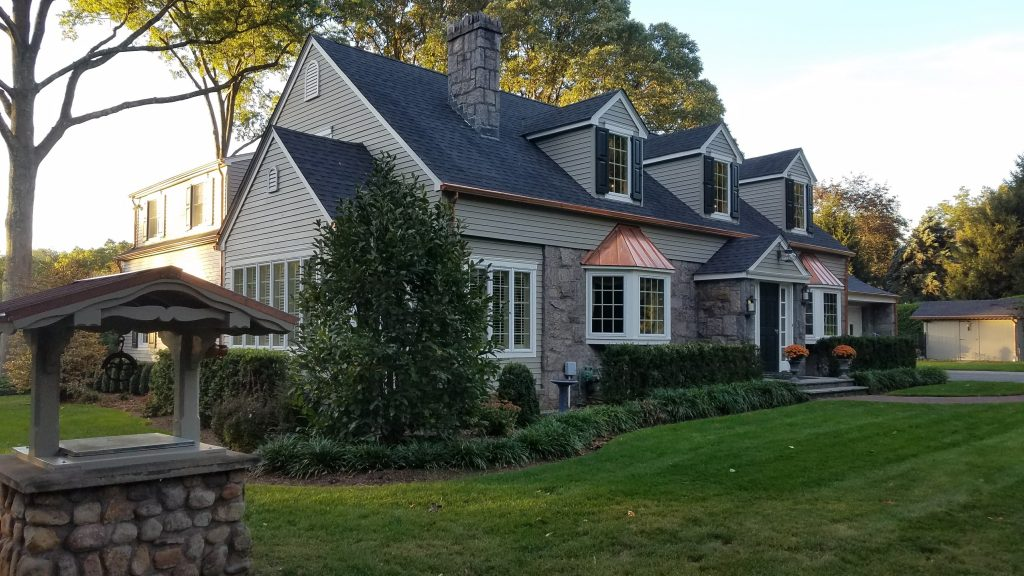Cape Cod with copper details and functional exterior shutters