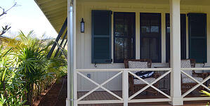 Blue Louvered Shutters on white beach home in Hawaii