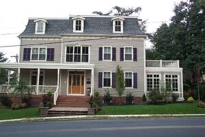 Purple louvers on gray home
