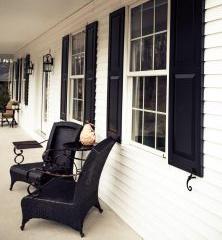 Black panel shutter white house porch