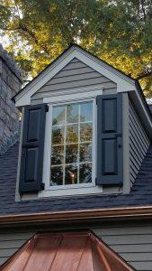 panel shutters on dormer window