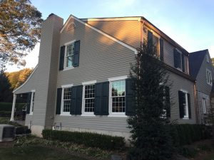 Functional exterior shutters on cape cod home
