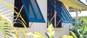 blue bahama shutters on white beach home