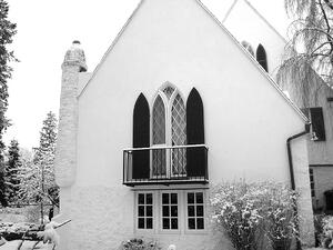 black louver arch top shutters on white church