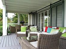 Green louver shutters on white porch