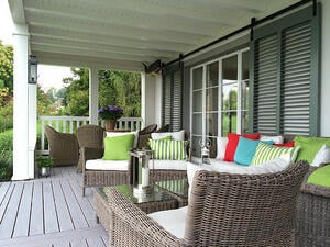 green fixed louver shutters on porch