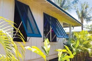 blue bermuda shutters on beach house bungalow