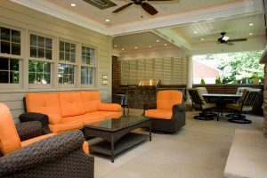 outdoor kitchen with white Bermuda shutters