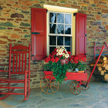 Red Panel endurian shutters on stone home