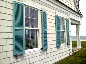 blue fixed louver beach house window shutters