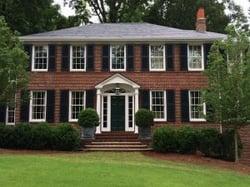 black shutters on classic brick home