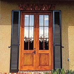 black louver shutters on wooden door