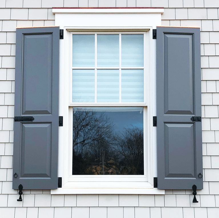 blue painted raised panel shutters with functional hardware