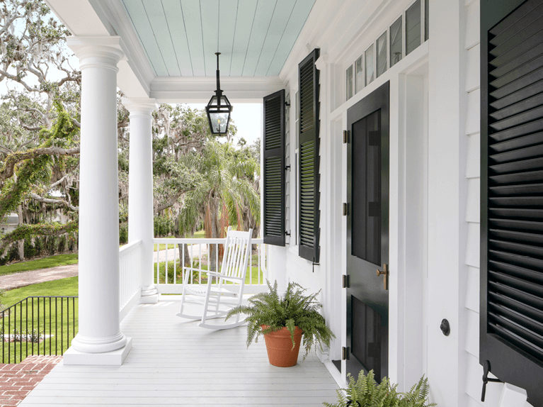 front porch with exterior shutters designed by florida custom builder nautilus homes