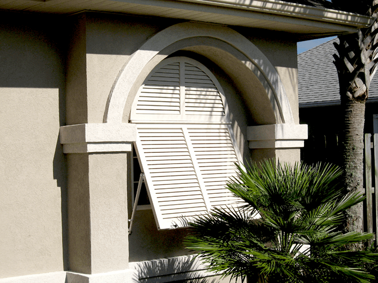 how to style a stucco home with white bermuda shutters