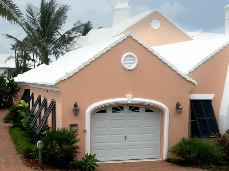 how to style a stucco home with black bermuda shutters