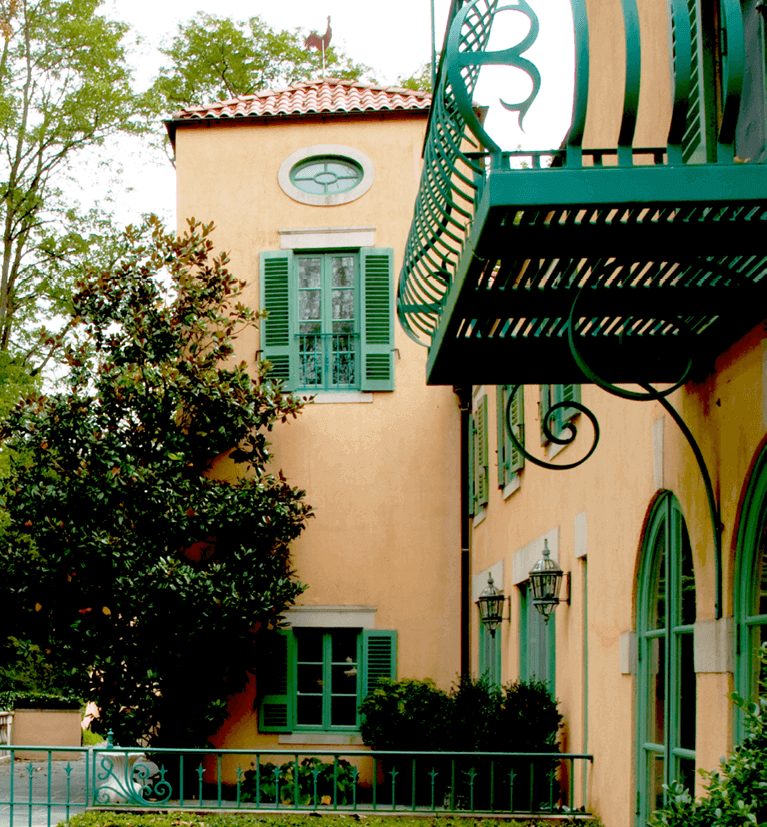 louver exterior shutters for a stucco mediterranean style home