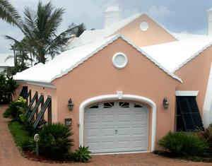 black bermuda shutters on peach stucco home