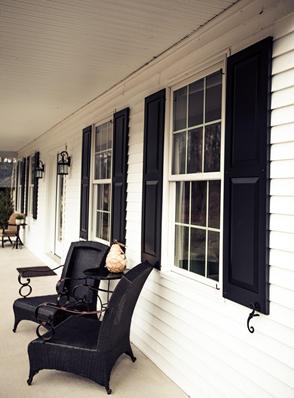 black panel shutters on white vinyl siding home