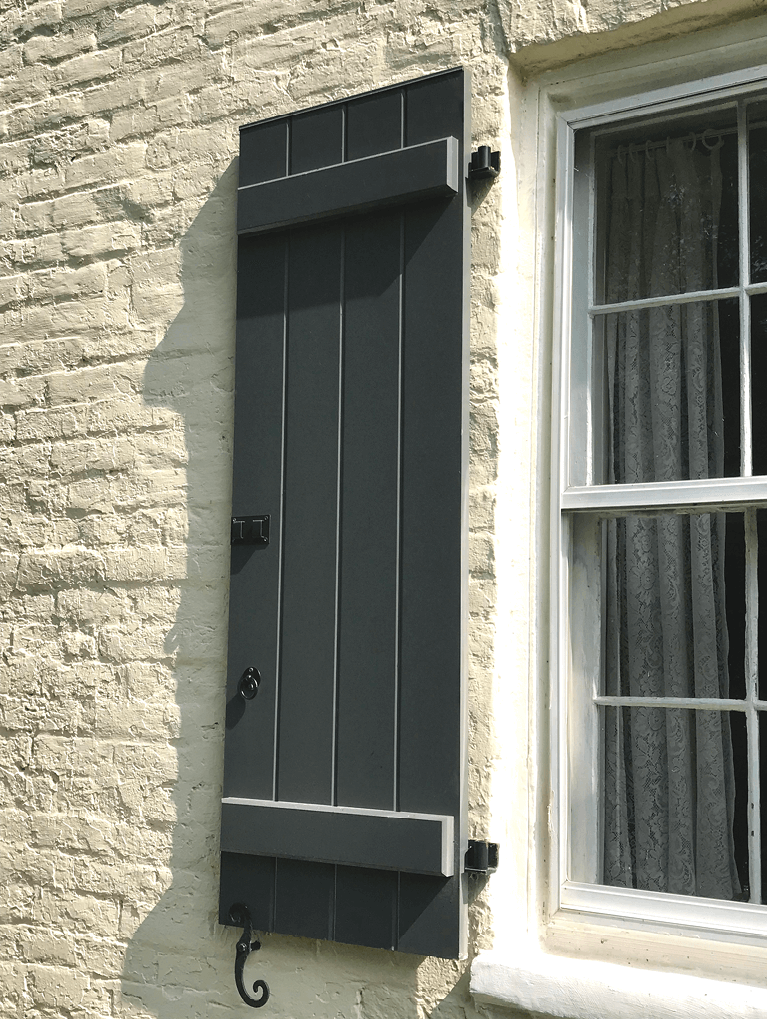 custom board and batten shutters with functional hardware